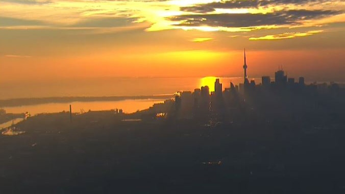 The sun sets behind the Toronto skyline as seen from the CTV News chopper on Thursday, Jan. 7, 2016.