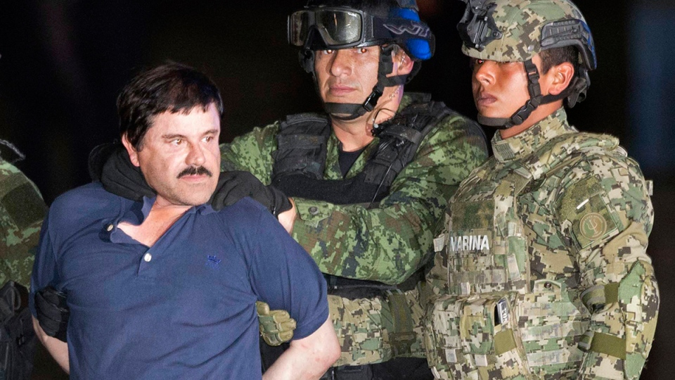 "Joaquin ""El Chapo"" Guzman is made to face the press as he is escorted to a helicopter in handcuffs by Mexican soldiers and marines at a federal hangar in Mexico City, Mexico, Friday, Jan. 8, 2016. (AP / Eduardo Verdugo)"