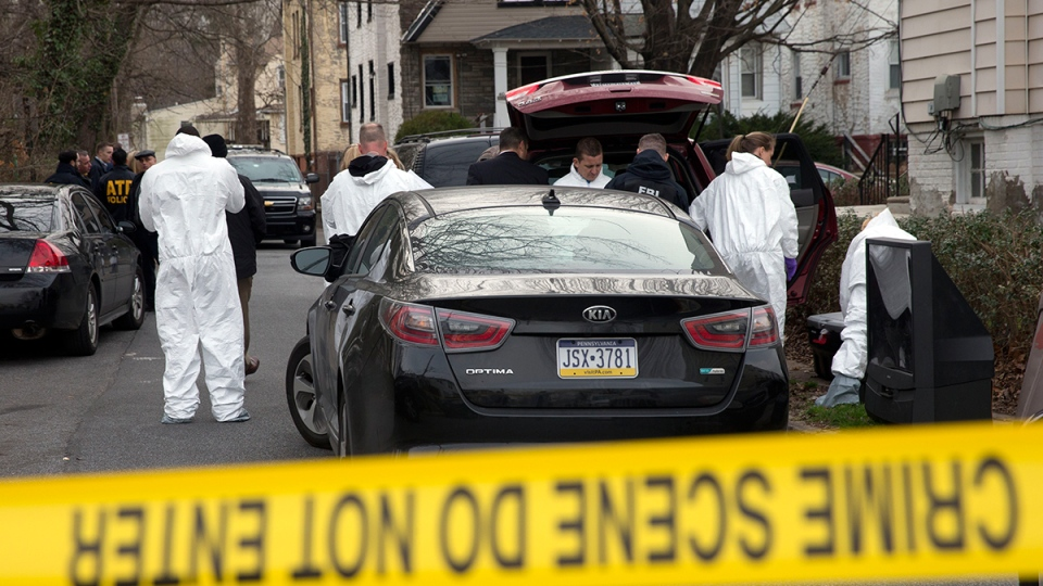 Investigators prepare to enter one of the residences where suspect Edward Archer has lived Friday, Jan. 8, 2016, in Yeadon, Pa. (AP / Matt Rourke)