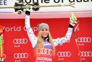 Lindsey Vonn, of the United States, celebrates on the podium after winning an alpine ski, women's World Cup downhill, in Altenmarkt-Zauchensee, Austria, Saturday, Jan 9, 2016. (AP/Pier Marco Tacca)