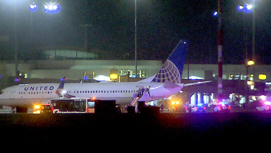 Emergency crews are shown meeting a United Airlines flight at Vancouver International Airport, after it was diverted there due to a security threat on Saturday, Jan. 9, 2016.
