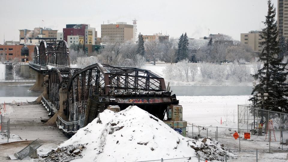 Two spans of Saskatoon's historic Traffic Bridge sit destroyed after demolition crews blew up a portion of the bridge. (Kevin Menz/CTV Saskatoon)