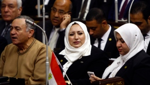 Members of Egypt's Parliament attend the inaugural session, the first to convene in three years, Cairo, Egypt, Sunday, Jan. 10, 2016. (Lobna Tarek, El -Shorouk Newspaper via AP)