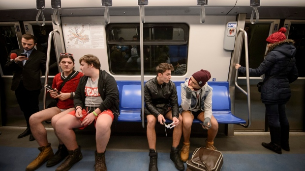 Youngsters ride on a train as they take part in the No Pants Subway Ride in Bucharest, Romania, Sunday, Jan. 10, 2016. (Andreea Alexandru / Mediafax via AP)