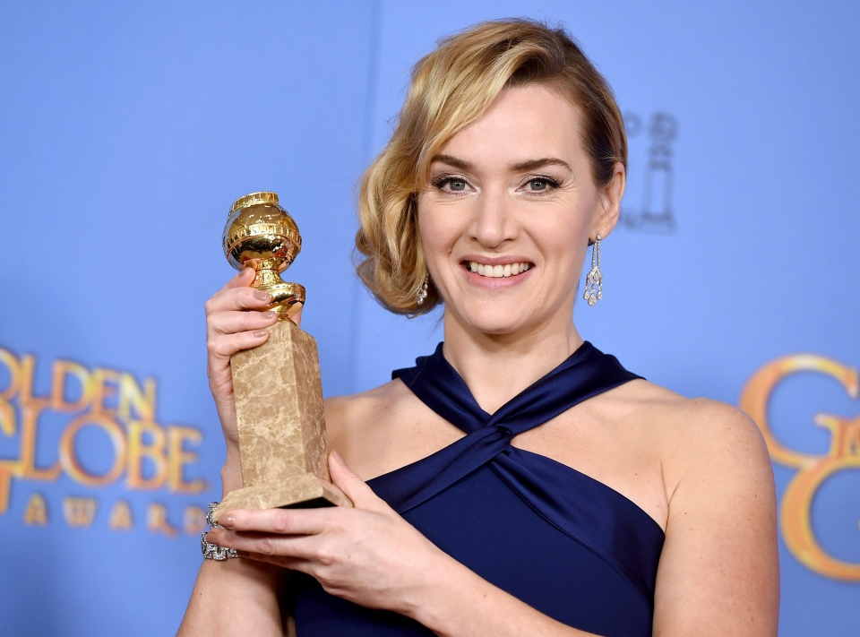 Kate Winslet poses in the press room with the award for best performance by an actress in a supporting role in a motion picture for 'Steve Jobs' at the 73rd annual Golden Globe Awards at Beverly Hilton Hotel in Beverly Hills, Calif. on Sunday, Jan. 10, 2016. (Invision / Jordan Strauss)
