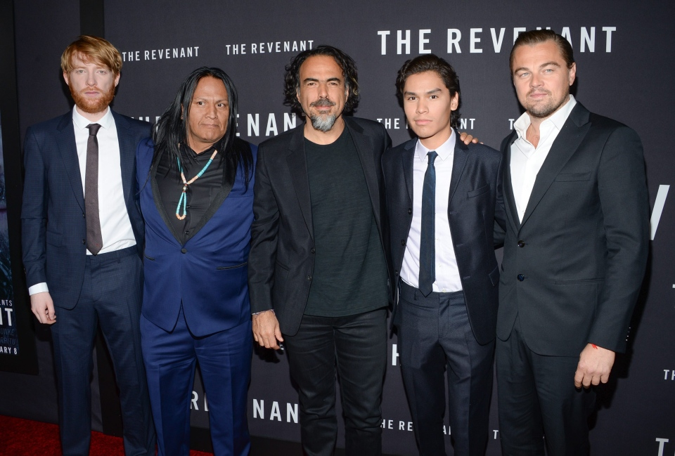 "Director Alejandro G. Inarritu, center, poses with actors, from left, Domhnall Gleeson, Arthur Redcloud, Forrest Goodluck and Leonardo DiCaprio at the premiere for ""The Revenant"" at AMC Loews Lincoln Square on Wednesday, Jan. 6, 2016, in New York. (Photo by Evan Agostini/Invision/AP)"
