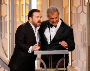 Gost Ricky Gervais, left, and Mel Gibson appear on stage at the 73rd Annual Golden Globe Awards at the Beverly Hilton Hotel in Beverly Hills, Calif., on Sunday, Jan. 10, 2016. (Paul Drinkwater/NBC via AP)