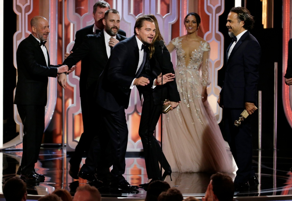 In this image released by NBC, Leonardo DiCaprio, centre, appears on stage with the cast and crew of 'The Revenant,' after the film won best motion picture drama during the 73rd Annual Golden Globe Awards in Los Angeles on Sunday, Jan. 10, 2016.
