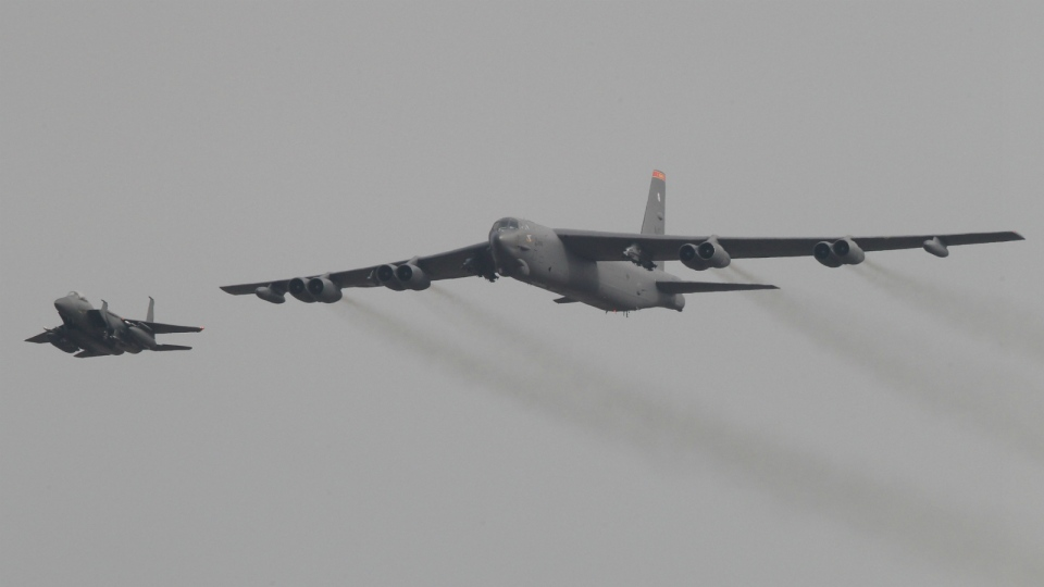 A U.S. Air Force B-52 bomber flies over Osan Air Base in Pyeongtaek, South Korea on Sunday, Jan. 10, 2016. (AP / Ahn Young-joon)