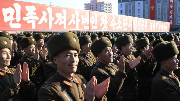 North Korean soldiers applaud bomb test