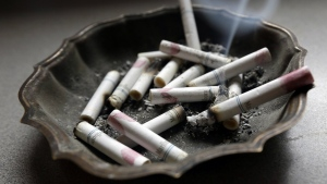 A cigarette burns in an ashtray at a home in Hayneville, Ala. on Saturday, March 2, 2013. (AP / Dave Martin)