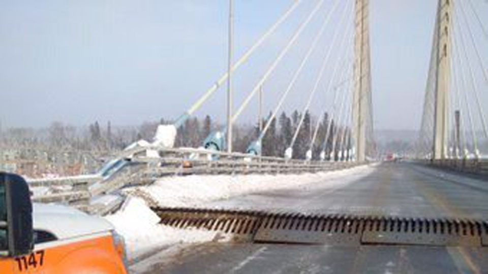 The Ontario Provincial Police posted this photo on Twitter on the damaged Nipigon River Bridge on Sunday, Jan. 10, 2016.  (Ontario Provincial Police via Twitter / THE CANADIAN PRESS)