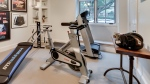 Time is one of the biggest barriers to starting or sticking with your fitness program, so building your own gym at home could be a great solution with so many benefits. (AP Photo/Rogers Healy and Associates Real Estate)