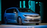 The 2017 Chrysler Pacifica Hybrid minivan is unveiled at the North American International Auto Show, Monday, Jan. 11, 2016, in Detroit. Chrysler claims this hybrid model will do 80 miles per gallon. (AP Photo/Tony Ding)