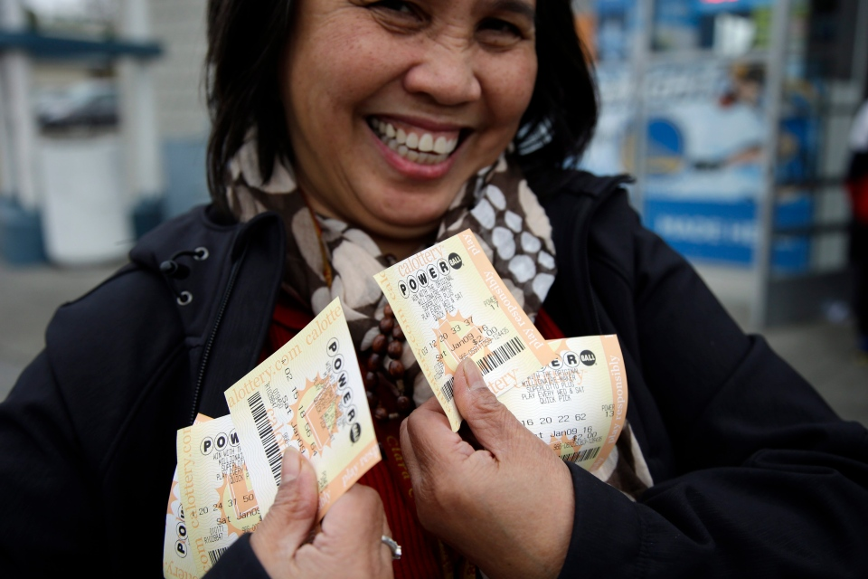 Zaida Cobangbang, of Union City, Calif., shows her Powerball tickets shortly after buying them Saturday, Jan. 9, 2016, in San Lorenzo, Calif. (AP / Marcio Jose Sanchez)