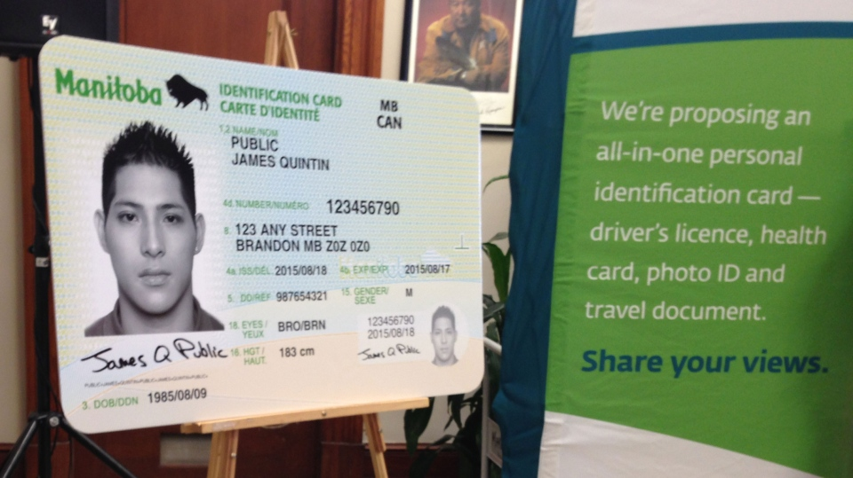An example of the government's proposed all-in-one identification cards is on display during an announcement on Jan. 11, 2016.