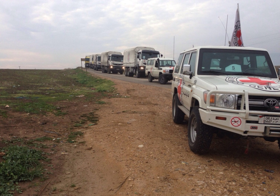This picture provided by The International Committee of the Red Cross (ICRC), working alongside the Syrian Arab Red Crescent (SARC) and the United Nations (UN), shows a convoy containing food, medical items, blankets and other materials on its way to the towns of Foua and Kfarya in northern Syria, Monday, Jan. 11, 2016. (ICRC via AP)