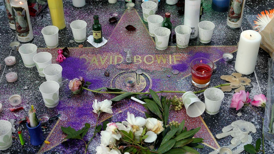 A makeshift memorial surrounds David Bowie's star on the Hollywood Walk of Fame in Los Angeles, Monday, Jan. 11, 2016. (AP / Nick Ut)
