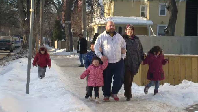 A recently-relocated Syrian family adjusts to a Winnipeg winter on Jan. 4, 2016.