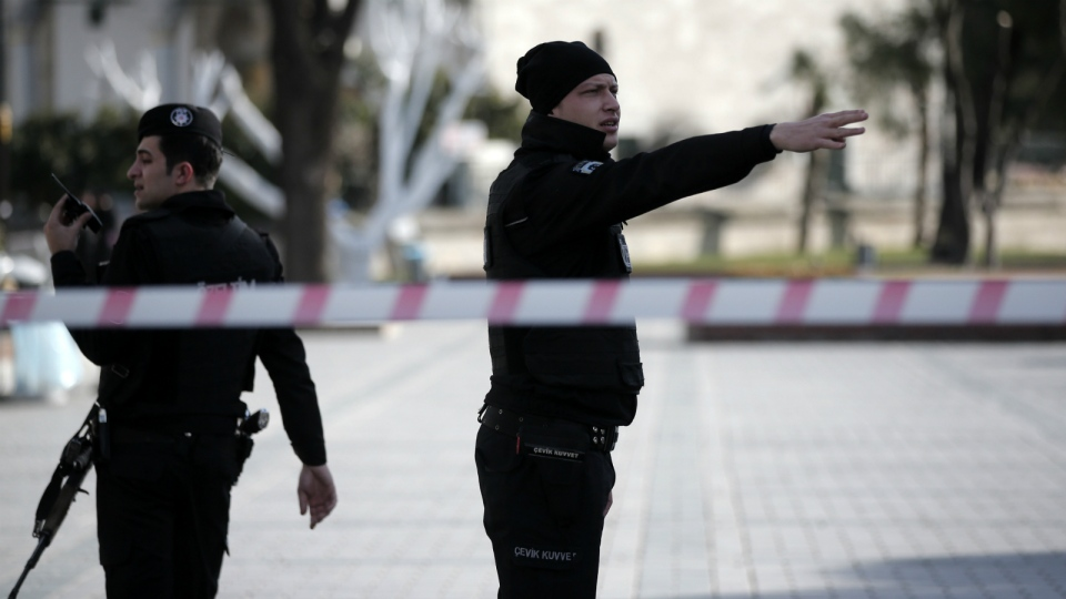 A policeman gestures as he patrols with a colleague at the historic Sultanahmet district after an explosion in Istanbul on Tuesday, Jan. 12, 2016. (AP / Lefteris Pitarakis)