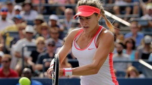 In this Sept. 4, 2015 file photo, Eugenie Bouchard, of Canada, returns a shot during the third round of the U.S. Open tennis tournament in New York. (AP / Charles Krupa)