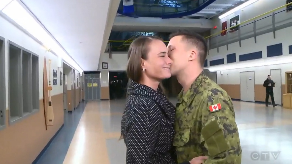 Courtney Halfpenny and Pte. Chris Chabaylo embrace after she accepted his marriage proposal.