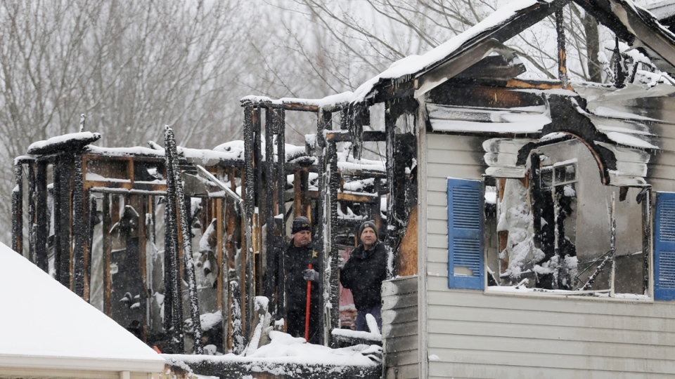 Investigators search a house explosion in Northfield Center Township, Ohio, on Jan. 12, 2016. (Tony Dejak / AP)