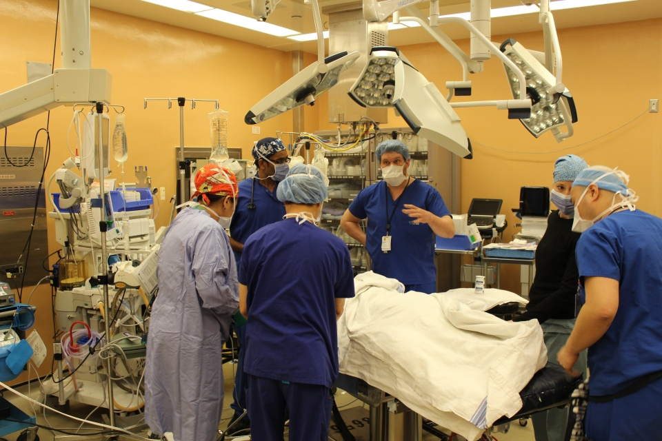The operating room team, including surgeons, anesthesiologists and nurses, begin preparing the patient for surgery. (University Health Network)
