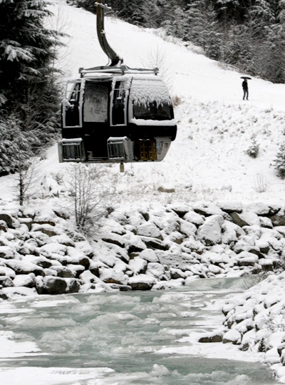 A gondola car hangs over a creek due to a damaged gondola tower at Blackcomb Mountain in Whistler, B.C., on Wednesday Dec. 17, 2008. (Darryl Dyck / THE CANADIAN PRESS)