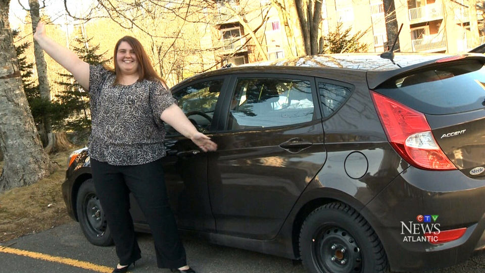 Lottery winner Jamie MacKenzie poses with her Hyundai Accent in Halifax, N.S., on Tuesday, Jan. 12, 2015.