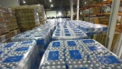 Thousands of bottles of water await distribution in a warehouse on Tuesday, Jan. 12, 2016. (Dale G. Young / The Detroit News)