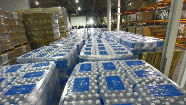 Bottled water await distribution in Flint