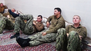 This picture released by the Iranian Revolutionary Guards on Wednesday, Jan. 13, 2016, shows detained American Navy sailors in an undisclosed location in Iran. Iranian state television is reporting that all 10 U.S. sailors detained by Iran after entering its territorial waters have been released. (Sepahnews via AP)