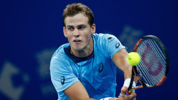 Vasek Pospisil of Canada returns a ball against Rafael Nadal of Spain during their second round men's singles match of the China Open tennis tournament at the National Tennis Stadium in Beijing, Wednesday, Oct. 7, 2015. (AP / Andy Wong)