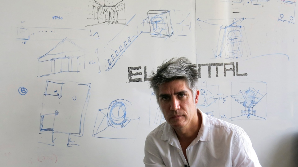 Chilean architect Alejandro Aravena poses for a photo at his studio in Santiago, Chile, Tuesday, Jan. 12, 2016. Aravena has been named the 2016 recipient of the Pritzker Prize. (AP / Eva Vergara)