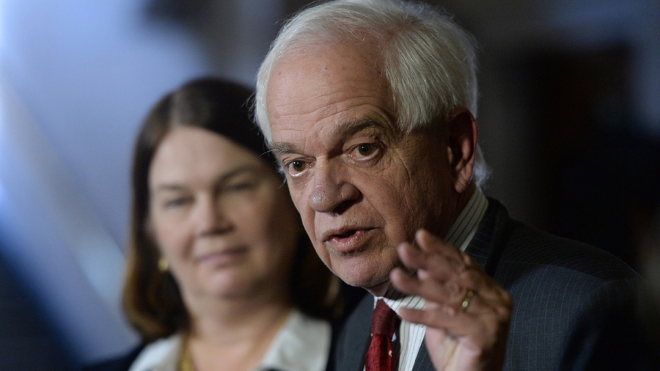 John McCallum, Minister of Immigration, Refugees and Citizenship, and Jane Philpott, Chair of the Cabinet Ad Hoc Committee on Refugees and Minister of Health speaks to reporters in the Foyer of the House of Commons prior to the meeting of the Ad Hoc Cabinet Committee on Refugees in Ottawa on Wednesday, Jan. 13, 2016. (Sean Kilpatrick / THE CANADIAN PRESS)