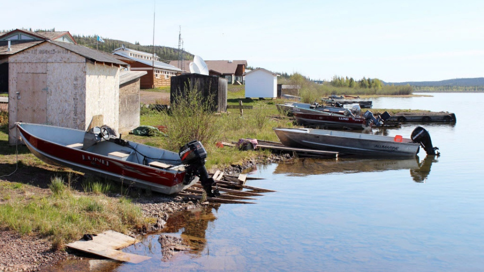 Fishing boats line the shoreline at Lutsel K'e, a Dene community of 350 people on Great Slave Lake in the boreal forest region of Canada's Northwest Territories in a June 2014 handout photo. (Sheldon Alberts / THE CANADIAN PRESS / HO)