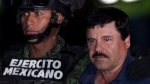 "Mexican drug lord Joaquin ""El Chapo"" Guzman, right, is escorted by soldiers and marines to a waiting helicopter, at a federal hangar in Mexico City, Friday, Jan. 8, 2016. (Marco Ugarte / AP Photo)"