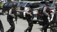 Police near site of explosion in Jakarta
