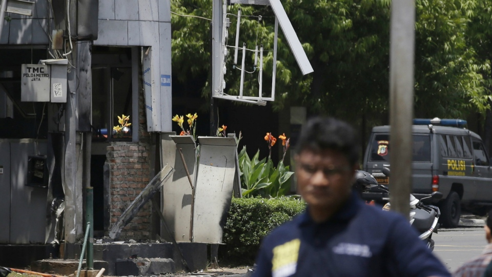 A police post in the center of Thamrin street across from Sarinah shopping mall is damaged after a bombing in Jakarta, Indonesia, Thursday, Jan. 14, 2016. (AP / Achmad Ibrahim)