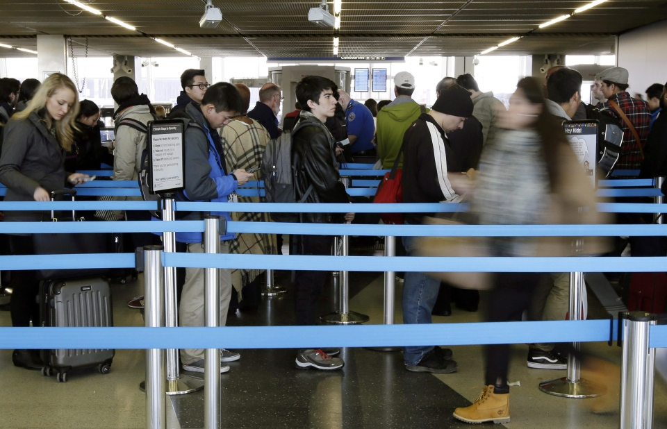 In this Nov. 25, 2015 file photo, travelers line up at a security checkpoint area in Terminal 3 at O'Hare International Airport in Chicago.  (AP Photo/Nam Y. Huh, File)