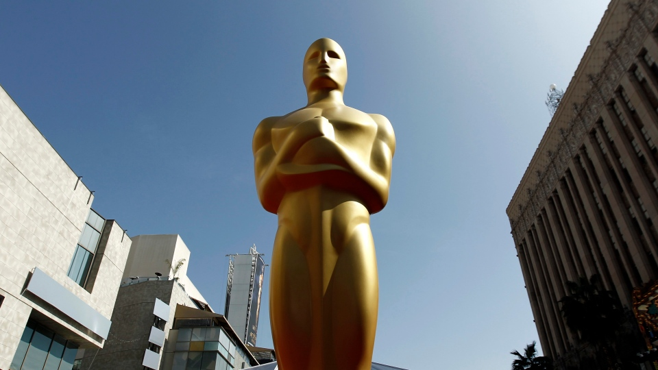 An Oscar statue is seen on the red carpet before the 84th Academy Awards in Los Angeles on Feb. 26, 2012. (AP / Matt Sayles)