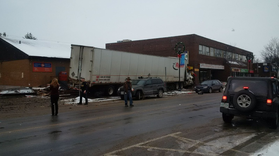 A tractor-trailer has crashed into buildings in Tottenham, Ont.