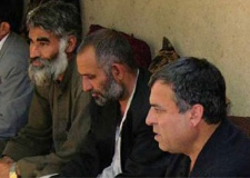 Tooryalai Wesa, second from right, is shown in a 2004 handout photo during a meeting in Afghanistan with grape growers. (University of British Columbia)