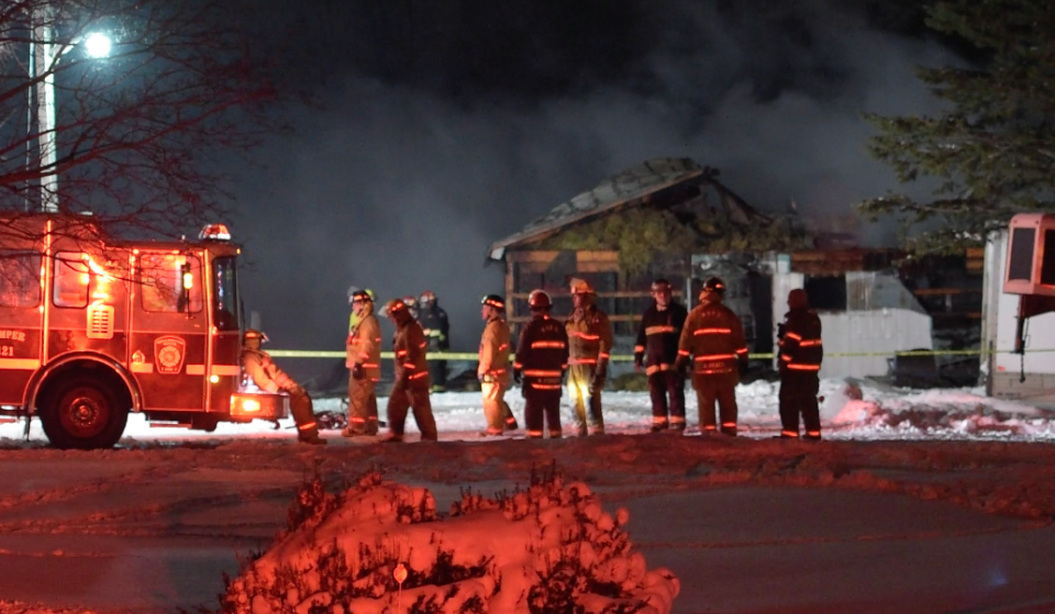 Firefighters are shown at the scene of a barn fire in Mt. Forest on Thursday night. (Andrew Collins)