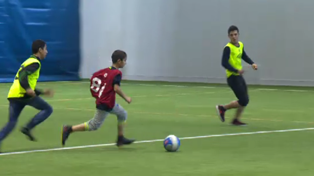 Syrian refugees play soccer