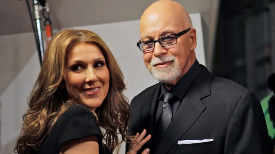 Celine Dion, left, poses with her husband Rene Angelil as they arrive for the premiere of the film 'Celine: Through the Eyes of the World' in Miami Beach, Fla., Feb. 16, 2010. (AP / Lynne Sladky)