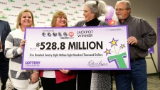 Powerball winners hold jackpot cheque in Nashville