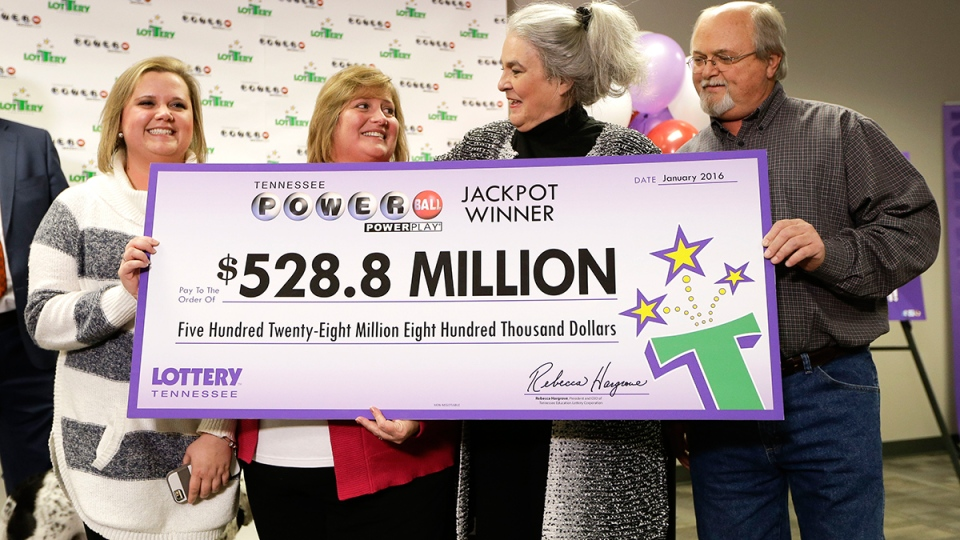 Rebecca Hargrove, second from right, president and CEO of the Tennessee Lottery, presents a ceremonial check to John Robinson, right; his wife, Lisa, second from left; and their daughter, Tiffany, left; after the Robinson's winning Powerball ticket was authenticated at the Tennessee Lottery headquarters, in Nashville, Tenn., Friday, Jan. 15, 2016. (AP / Mark Humphrey)