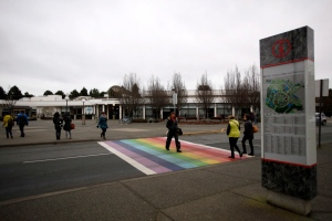 Students are seen crossing the Ring Rd. following the announcement of the world's only chair in transgender studies at The University of Victoria in Victoria, B.C., Friday, January 15, 2016. (THE CANADIAN PRESS / Chad Hipolito)